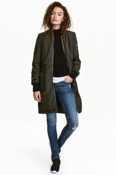 6b124478 Long bomber jacket in woven fabric with a slight sheen. Ribbed stand-up  collar, zip at front, side pockets, sleeve pocket with zip, and