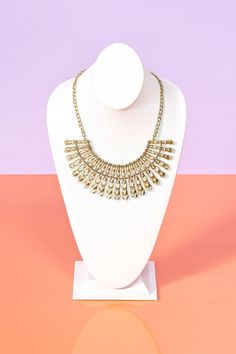 Kind of love this. All heavy metal is okay by me right now. Cleo Collar Necklace, $30, NastyGal