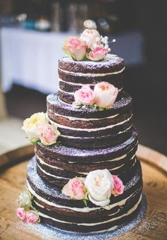 "11 Naked Wedding Cakes That Are Downright Gorgeous Unfrosted, or ""naked"" cakes have been one of the biggest wedding trends of the past year. Truly versatile, these cakes have taken the wedding industry by storm. Goodbye fondant and hello barely-there Brownie Wedding Cakes, Wedding Cake Fillings, Cake Wedding, Wedding Bride, Wedding Ceremony, Wedding Flowers, Wedding Wishes, Purple Wedding, Pretty Cakes"