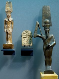 Figures of God Amun, Min-Amun and miniature stela displayed at the Louvre.