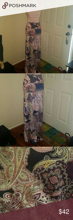 Beautiful Maxi skirt with Floral Paisley Design.. PRETTY PASTEL FLORAL AND PAISLEY PRINTED MAXI SKIRT . Super Silky and Stretchy Material..So pretty. 1 small and 1 medium size only. Once gone they're gone. Floral Silky Maxi Skirts Maxi