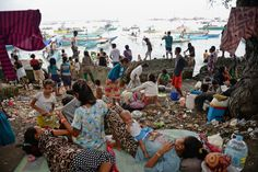 Sept. 11, 2013. Residents living along the coast near the area of a stand-off between the Philippine military and Muslim gunmen in Zamboanga...