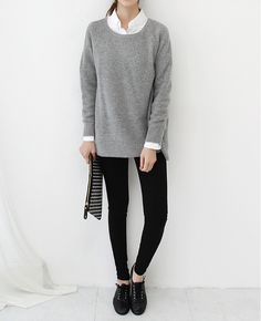 White + grey + black. Long sweater and skinny pants.