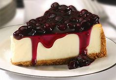 """""""This is a dense cheesecake that is very smooth and melts in your mouth. The white chocolate brandy sauce tops it off. I just nap it over the center of the slice of cheesecake on Cheesecake Day, No Bake Blueberry Cheesecake, Cheesecake Recipes, Dessert Recipes, Classic Cheesecake, Protein Cheesecake, Blueberry Cake, Yummy Treats, Delicious Desserts"""