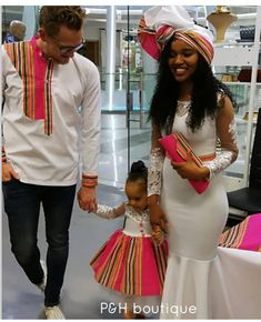 Image may contain: 2 people, people standing and text Couples African Outfits, African Dresses For Kids, African Print Dresses, African Fashion Ankara, Latest African Fashion Dresses, African Print Fashion, Venda Traditional Attire, Traditional African Clothing, Traditional Outfits