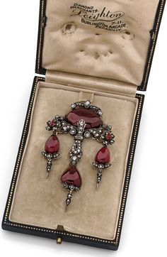 A Victorian antique silver, silver gilt, garnet and diamond brooch, by Leighton…