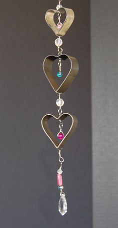 Valentine vintage upcycle cookie cutter assemblage wind chime mobile made from kitchen items, beads and wire. Wire Crafts, Bead Crafts, Noel Christmas, Christmas Crafts, Diy Wind Chimes, Heart Day, Upcycled Vintage, Repurposed, Beads And Wire