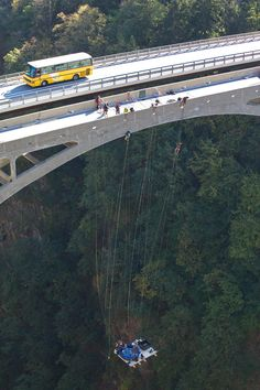 Extreme jacuzzi enthusiasts suspended 150 metres above the ground from the New Gueuroz bridge in Switzerland