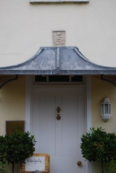 The Bowness door canopy. White structure with ornate finial. Tile effect roof pictured with dark drown tile effect roof also offered with terracotu2026 & The Bowness door canopy. White structure with ornate finial. Tile ...