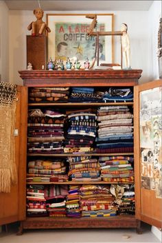 old quilts in wonderful armoire