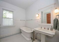 Historic 1910 home in the Broadway District. Bathroom with mosaic floor.