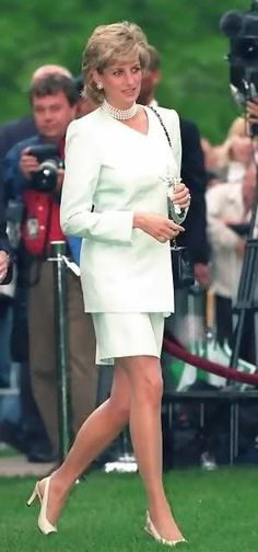 It's easy to look at Princess Diana in the pictures but look at the background at all the cameras too; after all that was her life and that was what killed her.