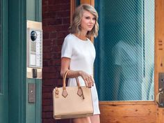 Taylor Swift wearing Michael Kors Casey satchel. May 2015