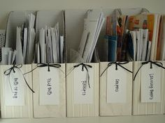 ORGANIZE YOUR MAIL... receipts, coupons, and bills. BUY a pack of 5 white cardboard magazine holders from Ikea for $2.99. Glue some scrapbook paper on the front of them with modge podge. Then  punch holes in the front and tie tags to each one with ribbon. Print the labels from the computer. Examples...boxes for Bills to pay, Paid bills, Receipts, Coupons, and maybe project info.