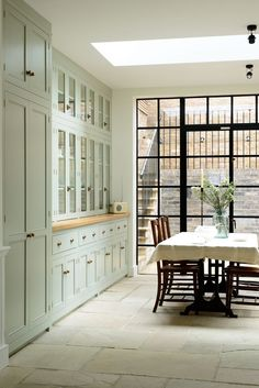 We could do wood counter for the baking area - as it sits out a bit like this? Wonderful DeVol English kitchen.