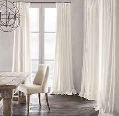 Belgian Heavyweight Textured Linen Drapery. I like these the best, in white. I also like the way they have rings at the top, not just slid onto pole, and not pinch pleated.