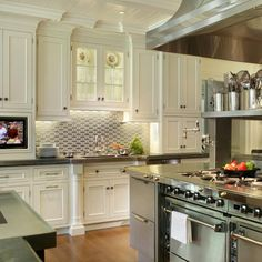 White shaker kitchen cabinets are flexible and adjustable in their style. This means they can be the perfect base for your traditional kitchen plan or they can become modern kitchen dream.    White Shaker Cabinetry with Stainless Steel Kitchen Design by Peter Salerno  #whiteshaker #whiteshakercabinets #whiteshakerkitchen #kitchendesign #kitchenremodel #whiteshakerkitchen #kitchensofinstagram #interiordesign #interiordesigner #hireadesigner #designmatters #dreamkitchen #whiteshakercabinetry
