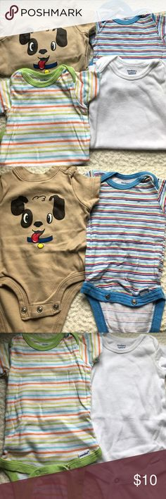 Set of 4 onesies 2 striped patterned onesies. A cute dog onesie and a white one. All in great condition and all 0-3 months DON'T FORGET Bundle with 3 or more items and get 15% off 😀 One Pieces Bodysuits