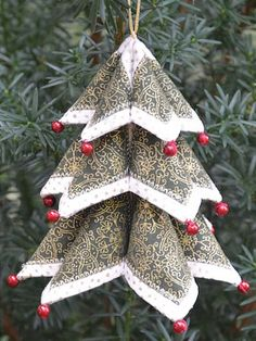 """Dimensional ornaments to decorate the tree, create package tie-ons, or dress up a mantel. The patterns come together nicely, making this a perfect afternoon or weekend project. Wreath Ornament 5"""" across Tree Ornament 5"""" high Medium Tr..."""