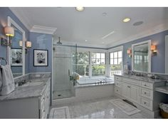 Our inspiration photo- white carerra marble and subway tile. Blue bathroom with white vanity