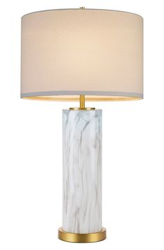 A smooth natural shade tops this glossy, marbled-glass table lamp for a stately, elegant design accent.