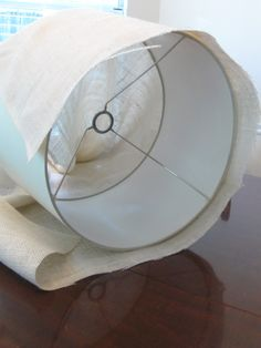 add texture by recovering a lamp shade with burlap - a pottery barn  knock-off