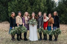 Winter wedding featuring greenery bouquets.  Flowers by Buckeye Blooms.  Photo by Sarah Hissong.