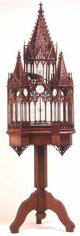 Gothic bird cage, mahogany, ca. 1880.  The cage was made by Mr. Shultie who came from Germany. He was a cabinet maker by trade. He gave it to his wife as a gift on their 25th anniversay. It was given to Mrs. Steckler after Mrs. Shultie passed away and has been in her care since the fall of 1906. Mrs. Shultie passed away on Aug. 3, 1960 and was 97 1/2 years old, at Forest Knolls, Marin Co., Ca.