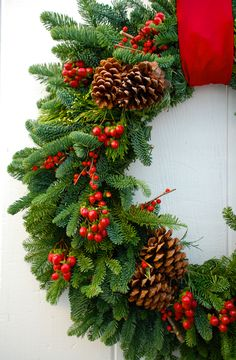 Beautiful traditional wreath with red ilex berries and hypericum berries