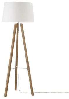 Tripod Wood Floor Lamp - $249.00 » Modern tripods are usually made of metal, but this simple wooden version has loads of natural appeal. Add this lamp to a space that needs an extra bit of warmth