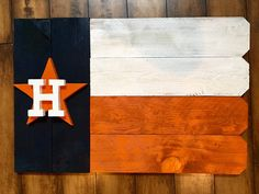 Are you looking for the perfect Fathers day or birthday gift? This sports sign is one of a kind! Made from cedar fence posts. Logo is Hand painted. Tell us your favorite team and we will custom make it. Dimensions: approximately We seal our signs with an Rustic Signs, Wooden Signs, Astros Team, Houston Astros, Texans, Wood Projects, Craft Projects, Craft Ideas, School Projects