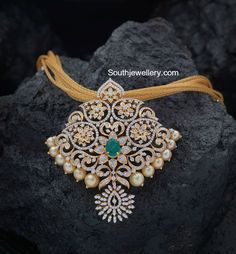 22 carat gold mesh chain with floral diamond pendant studded with diamonds, emerald and south sea pearls by Creations Jewellery, Bangalore. Buy Diamond Ring, Diamond Pendant, Diamond Jewelry, Gold Jewelry, Fine Jewelry, Diamond Necklaces, Gold Necklaces, Bridal Jewelry, Diamond Mangalsutra
