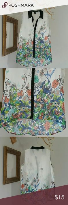 """Timing Floral Button down Top Silky polyester draped with flowers and butterflies. Solid black collar and button piping in contrast to the white background makes it versatile. No snags, stains or rips.  The details.. ... Shoulder width  = 13"""" Front length = 22""""-23"""" Back length  = 27"""" Bust = 18""""  **Please note.. ... Items listed are in pre-loved condition (unless noted as NWT). I sincerely look over all the details; however, I encourage you to review and ask for additional details before…"""