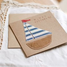 Items similar to Nautical Fabric Boat Birthday Card Invitation -Recycled Paper Card on Etsy - - Items similar to Nautical Fabric Boat Birthday Card Invitation -Recycled Paper Card on Etsy Männerkarten Karte mit Stoffboot aufgenäht Freehand Machine Embroidery, Free Motion Embroidery, Fabric Cards, Paper Cards, Card Invitation, Karten Diy, Sewing Cards, Boy Cards, Kirigami