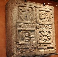 Images from the National Museum of Anthropology-- Stone of the four glyphs  This stone relief from Xochicalco measures time with the bar and dot numbering system--upper register signifies the date Four Rabbit.