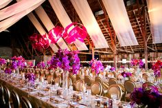 Make a statement with a bold contemporary sculpture. Pink, rose & fuchsia cast a glow over a rose gold room adorned with gold mercury candles, gold chairs topped with cascading floral arrangements of violet, fuchsia and hot pink using orchids, wine dahlias, ranunculus, creamy garden roses and delicate lilies. Design by Waterlily Pond / Floral Artistry & Event Design / San Francisco, California. Santa Lucia Preserve, Carmel Valley. Photos courtesy of Larissa Clevelend Photography.
