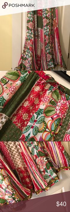 """Gorgeous multi colored lined  skirt NWOT 100% cotton, 39 inches long w/ 16"""" elastic stretchy waist w/ tie.  This a beautiful skirt that I purchased at an upscale Fl. Boutique and am selling for a song!  Will look marvelous w/ tank or T-shirt and lots of big Boho jewelry!  Is a midi or maxi depending on your height.  Never wore and now no need for it.  Make an offer! Peppermint Tree Skirts Maxi"""