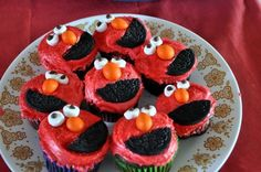 7 Easy Elmo Party ideas: Stick the sticker on Elmo's nose, chocolate chip and peanut M+M's cupcakes, Elmo ballons, Elmo's pet goldfish homemade lemonade! #birthday #kids #babies