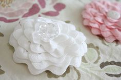 Really Easy Flowers - Learn how to make ric rac flowers to add to your projects with this fabric flower tutorial.