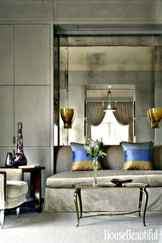 Mirrored panels like the ones lining this alcover can be very elegant and warm.  Section them into patterns and make them unique. Incorporate your style into your home using the mirrors. To receive our Pinterest eNewsletter, click on pin.