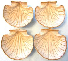 On offer is this lovely retro set of four dishes. All are in really good condition overall, no chips cracks or restoration and the colors look great still.  They each share a traditional seashell shape which have been beautifully hand decorated with a beige background glaze   #dishes#tableware#service, kitchenware,plate,cup,glass,porcelain