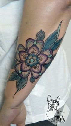 Purple turquoise flower tattoo