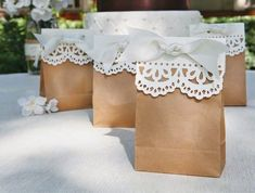 Brown Paper Gift Bags with Doilies and Ribbon. Nice for Shower or Wedding Favors. So simple, but awesome! Wedding Favors Cheap, Diy Wedding, Wedding Gifts, Trendy Wedding, Wedding Ideas, Craft Wedding, Wedding Bags, Wedding Inspiration, Wedding Dresses