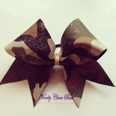 Items similar to Camo with Gold Foil over Black Cheer Bow with border, without border or tictoc on Etsy Softball Bows, Cheer Bows, Softball Stuff, Dance Bows, Cheerleading Quotes, Camouflage, Top Hairstyles, Diy Bow, Pony Hair