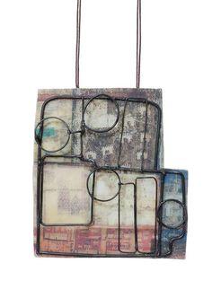 Lorena Lazard. Pendant: En el Centro de la Ciudad de México, 2015. Iron, Image transfer in polymer clay of antique and modern maps of Mexico City, mica. 10 x 9.5 x 1.5 cm. Photo by: Paolo Gori.