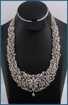 This is an extremely elegant Diamond long necklace. The necklace is made of floral pattern. The entire necklace is lavishly studded with sparkling diamonds. Diamond Jewelry, Gold Jewelry, Jewelry Necklaces, Bracelets, Diamond Rings, Gold Rings, Diamond Choker, Diamond Necklaces, Silver Ring