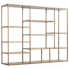 """Emerson Bookshelf by Redford House, $1,868, Redford House, Zinc Door.  """"This one I put under 'if you need a ton of books and storage space.' It's wide and large and gives you a ton of shelving. It also is in that very pretty, brass antique finish which is really on trend right now. And it has warm wood with hand-forged iron. It has a strong visual impact because of its geometric frames. It's really a looker--plus it has function."""" --Melissa McLay"""