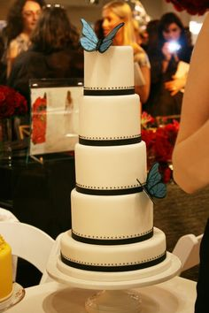Simple and graphic. black and white wedding cake with blue butterflies