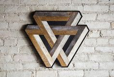 Handmade wood wall art with reclaimed wood pattern. We can customize sizes of this design in our shop if this one isnt just right for your space. This Penrose can be used on a wall needing some love, a shelf or mantel, or add it to a gallery wall. Easy to hang on one nail or screw. It can be hung from any side you choose. Size, color and texture will have small variations due to the nature of reclaimed wood. Made with raw reclaimed wood. Can be customized. This design is copyright protect...