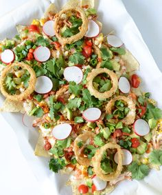 A fan favorite, serve BBQ Chicken Nachos with Buttermilk Onion Rings for a half-time snack!